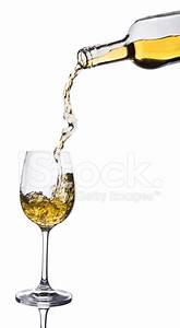 White Wine Pouring Into Glass from Bottle Stock Photos ...