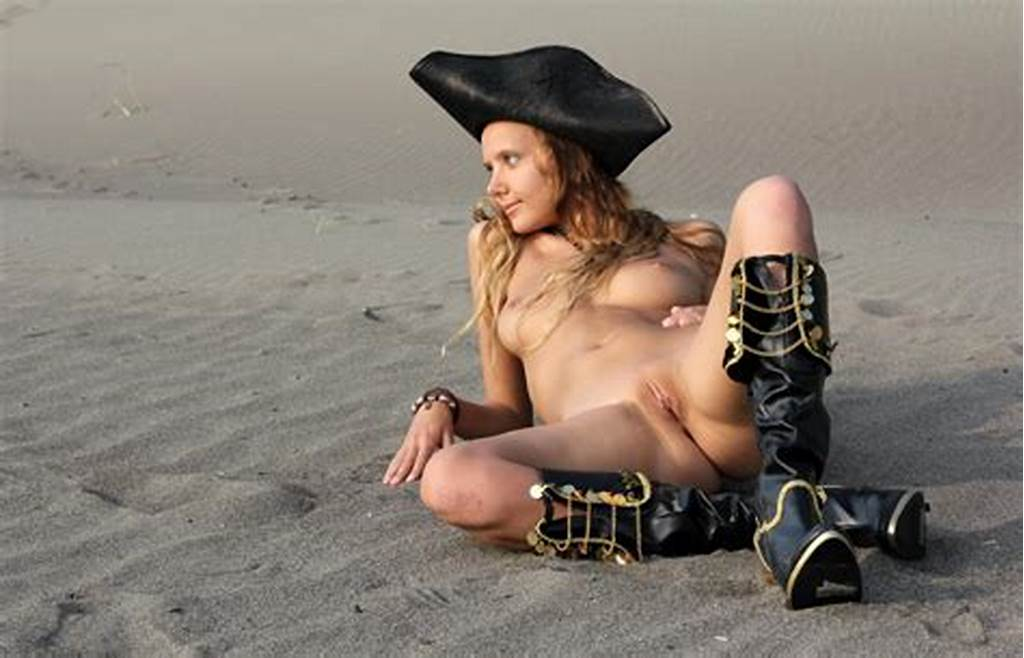 #Pretty #Young #Girl #Dressed #As #A #Pirate #On #The #Beach