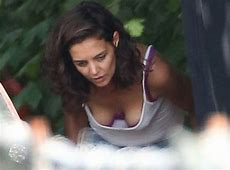 Katie Holmes Flashes Her Boobs and Bra While Bending Over