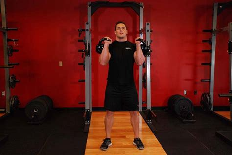 kettlebell thruster exercise conditioning mma weight training room
