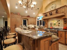 granite kitchen island with seating a two tiered kitchen island with granite countertops provides bar seating for four in this