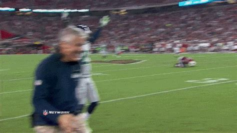 pete carroll laughing  brandon browner  tripped