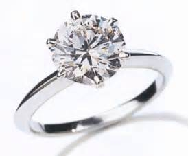 one of a engagement rings two golden rings 1 carat ring