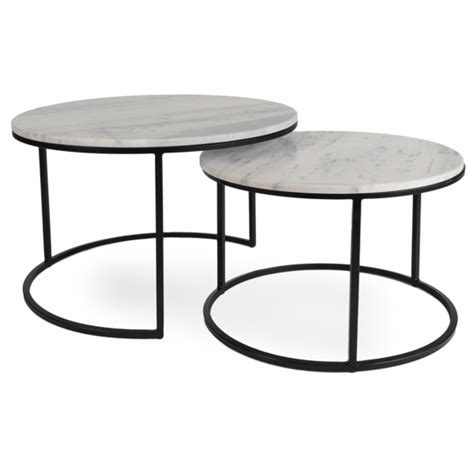 Scaled for smaller spaces, its nesting function lets you hide the smaller table under the larger one, and pull it out when you need more surface space. Carrara Marble Nesting Coffee Tables | Nesting coffee tables, Coffee table, Table