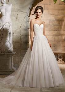 asymmetrically draped bodice on net wedding dress style With draped wedding dress
