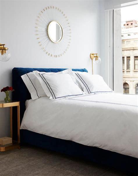 blue velvet tufted headboard  gold nightstands