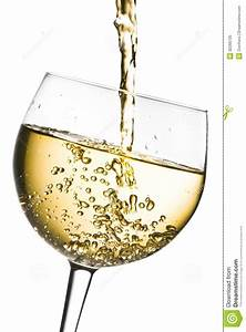 White Wine Pouring Into Glass Tilted With Space For Text ...