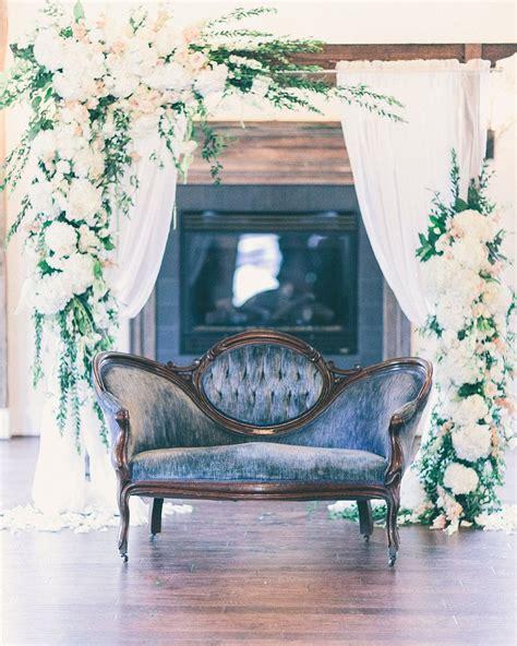 vintage blue velvet sofa  gorgeous floral decor image