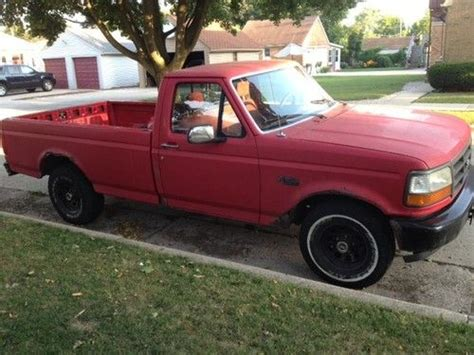 find  red ford   truck long bed manual cap