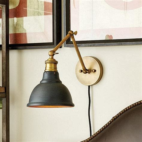 voltaire black and brass wall sconce