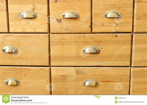 Old Wooden Antique Chest Of Drawers With Metal Handles Stock Photo