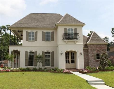 chateau lille stucco  taupe shutters black wrought