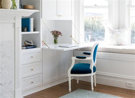 A Fold-down Desk Keeps Paperwork Within Reach But Out Of