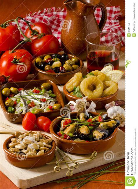 in cuisine cuisine assorted tapas on ceramic plates stock