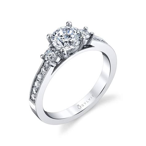 three stone engagement ring with milgrain detail