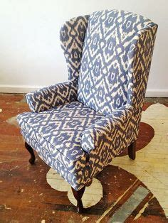 this blue and white ikat fabric on a wing back chair