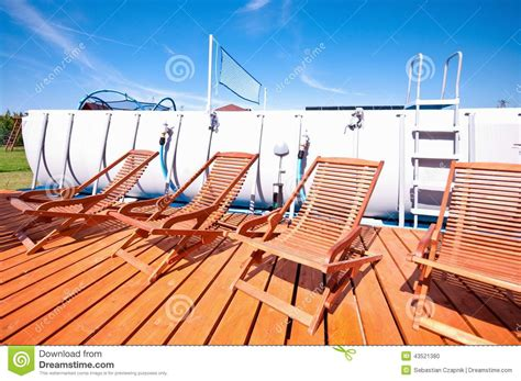 swimming pool deck chairs stock photo image 43521380