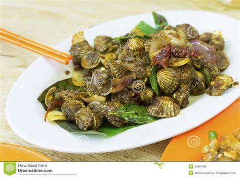 cuisine malaisienne cuisine malaisienne coques épicées de sambal photo stock