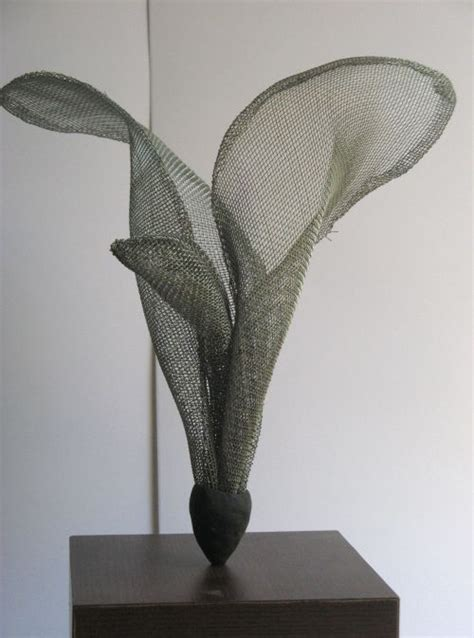 floral cross forms wire mesh wire sculpture by artist raghavendra hedge