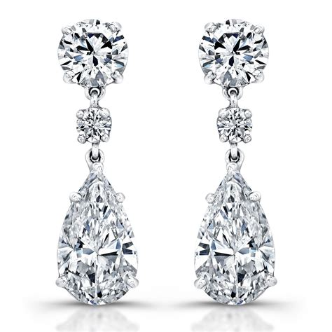shaped engagement ring pear earrings revere jewels