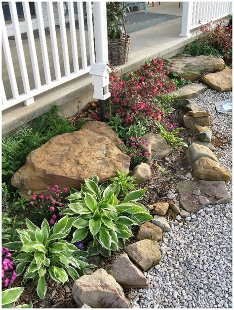 landscaping rocks and flower beds on