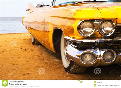 classic yellow flame painted cadillac  beach stock image