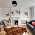 White Cowhide Rug Ikea by Magnificent White Cowhide Rug Ikea With Fireplace Mantel