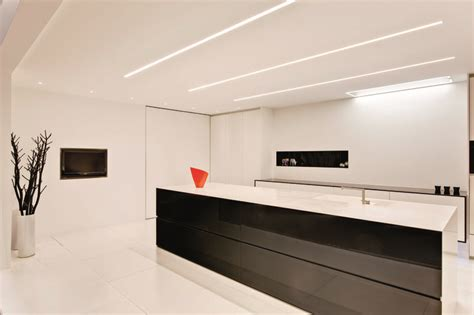 Subtle Colour Accents In A Clean White Kitchen Lighting