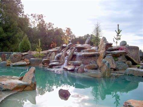 kitchen tv ideas rock boulder pool rustic pool sacramento