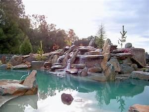 natural rock boulder pool - Rustic - Pool - Sacramento