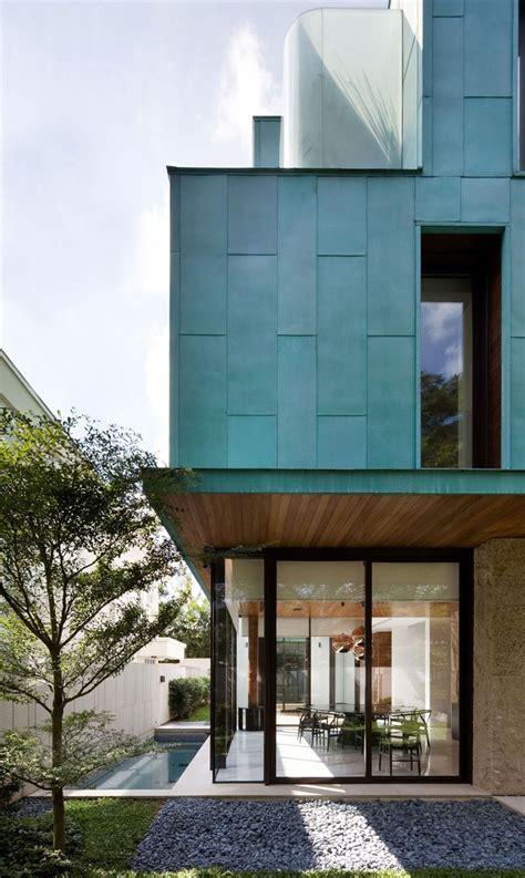 metallic exterior meets modern interiors  singapores green house