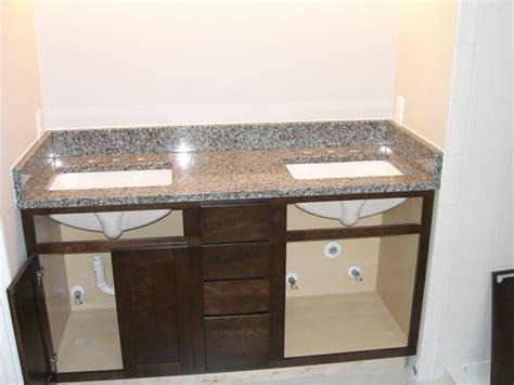azul platino granite countertop with cabinets