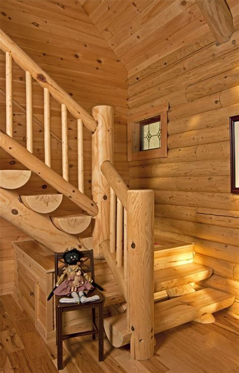 L shaped half log stairs lead to the upper level loft and