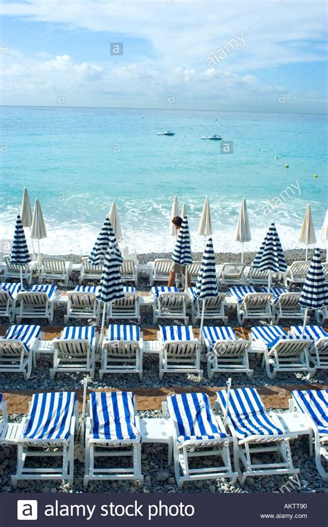 Nice France Beach Scene With Beach Chairs And Striped