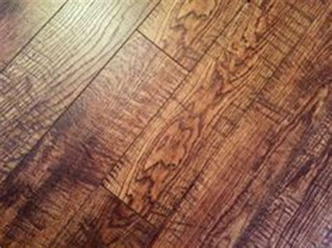 pergo sawn oak pergo xp highland hickory 10 mm thick x 4 7 8 in wide x 47 7 8 in length laminate flooring 13