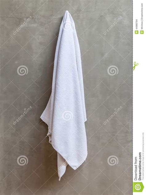 Towels Hanging In Bathroom Stock The White Towel Is Hanging On A Hanger With Concrete Wall