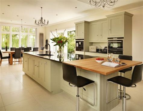 Kitchen Island And Breakfast Bar - a wooden breakfast bar and granite work surfaces blend seamlessly here on a statement painted