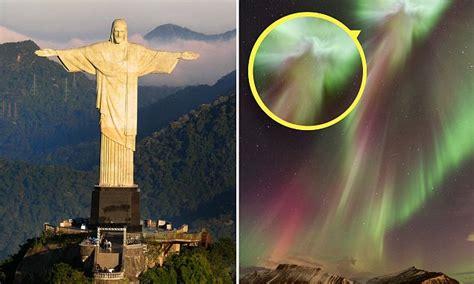 image  christ  redeemer appears  aurora borealis