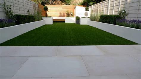 contemporary garden paving sawn sandstone paving easy grass raised beds hardwood screen and bench balham garden design