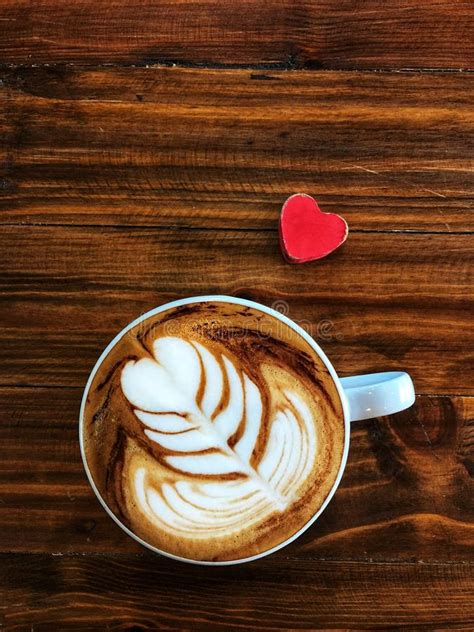 This is sort of the basic latte art design and then the other one would be a rosetta which is a fern, and then a tulip. Cup Of Love , Heart Latte Art Coffee In White Cup And Red Love Heart Stock Photo - Image of ...