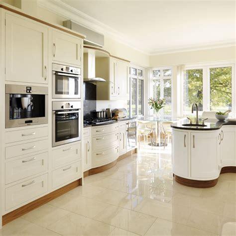 Sage Green Kitchen Cabinets With Black Appliances by Cream Kitchens 10 Beautiful Schemes