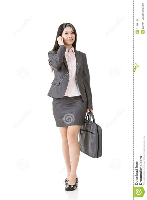 asian business woman talking   cell phone stock
