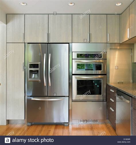 kitchen cabinet for wall oven kitchen wall featuring built in fridge and wall oven