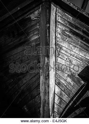 Bow Of Old Boat by Old Wooden Boat Bow Close Up Black And White Stock Photo
