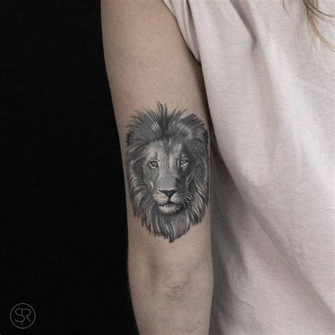 lion head tattoo      left arm tattoos