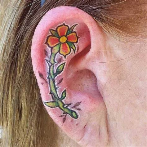 flower tattoo ear cartilage  tattoo ideas gallery