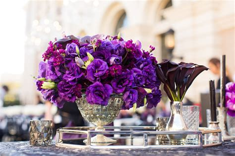 purple flower centerpieces  silver accents