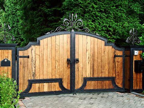 wooden driveway gates wood clad inserts  iron frames