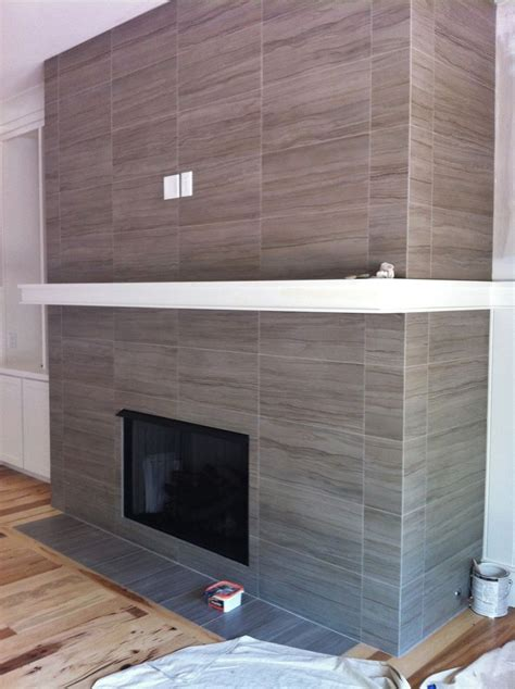 wall tile fireplace 12x24 porcelain tile on fireplace wall and return walls floor to ceiling tile jobs we ve