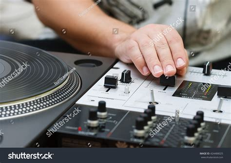 Hand Dj Mixing Music On Professional Stock Photo 424488025